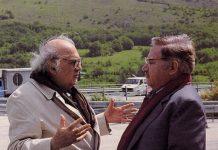 Federico Fellini e Paolo Villaggio sul set dello Spot della Banca di Roma (Il sogno della galleria)_ Fotografia di Mimmo Cattarinich